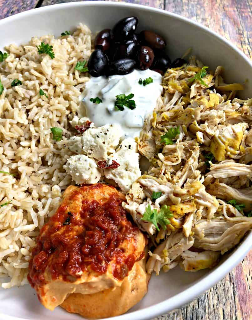 close up photo of mediterranean chicken bowl in a white bowl