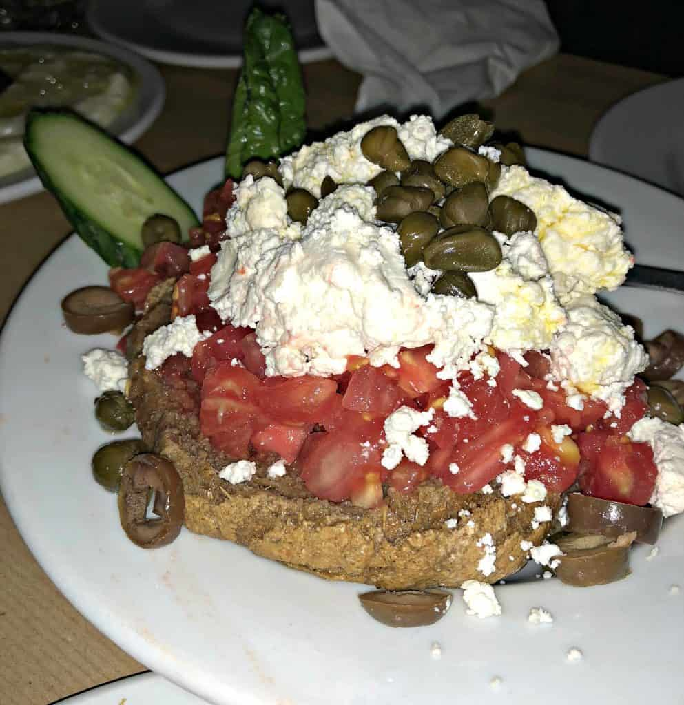 greek food with feta on a white plate