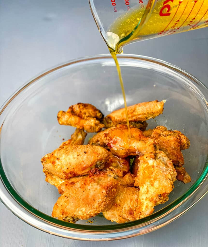 garlic butter parmesan sauce drizzled over chicken wings