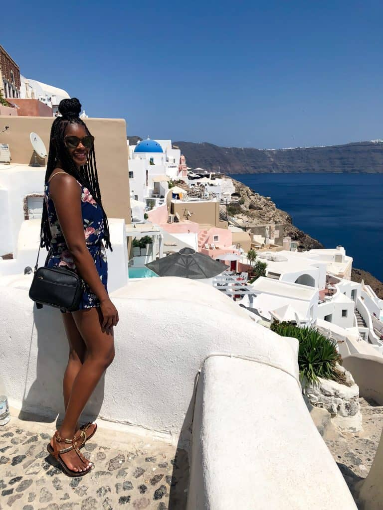 person standing in front of santorini village