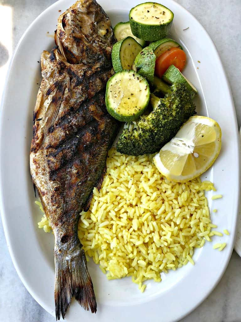 fresh fish with rice and vegetables