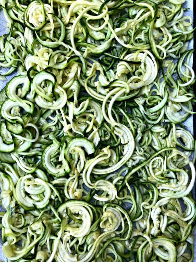 spriralized zucchini on a sheet pan