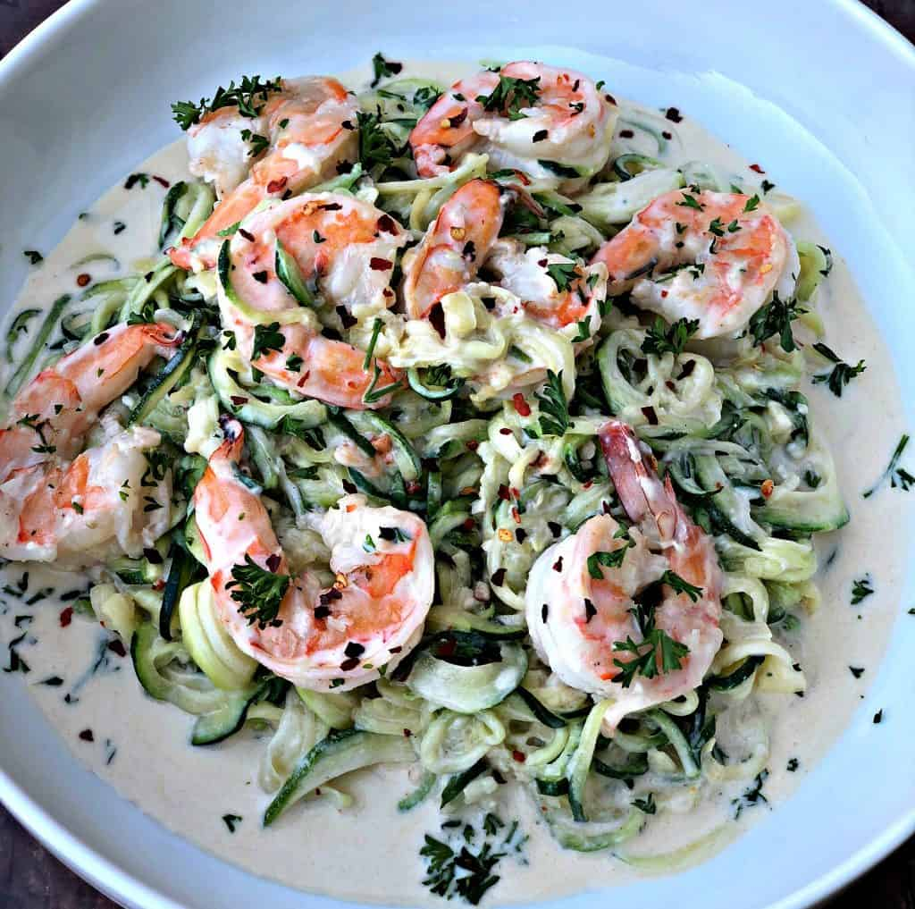 low carb zucchini alfredo in cream sauce on a white plate