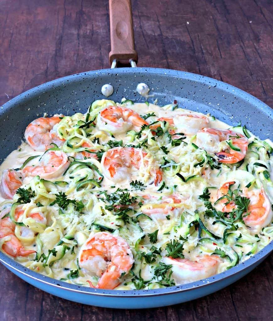 low carb zucchini alfredo in cream sauce in a skillet