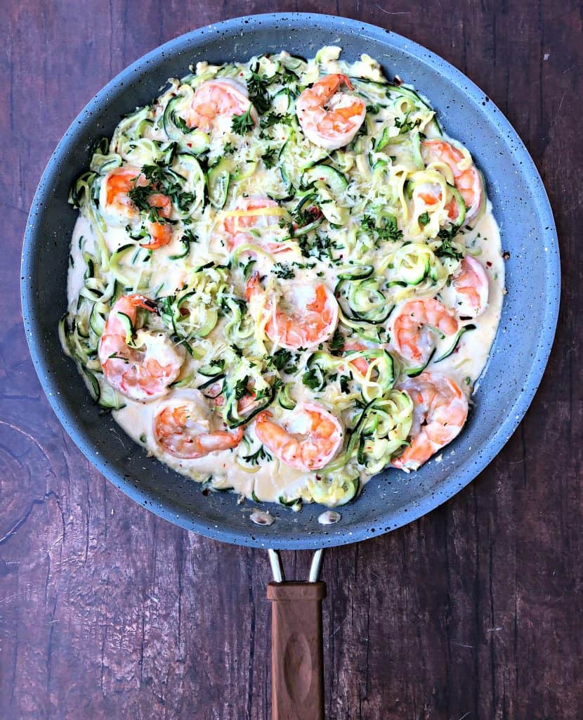 low carb zucchini alfredo in cream sauce in a skillet