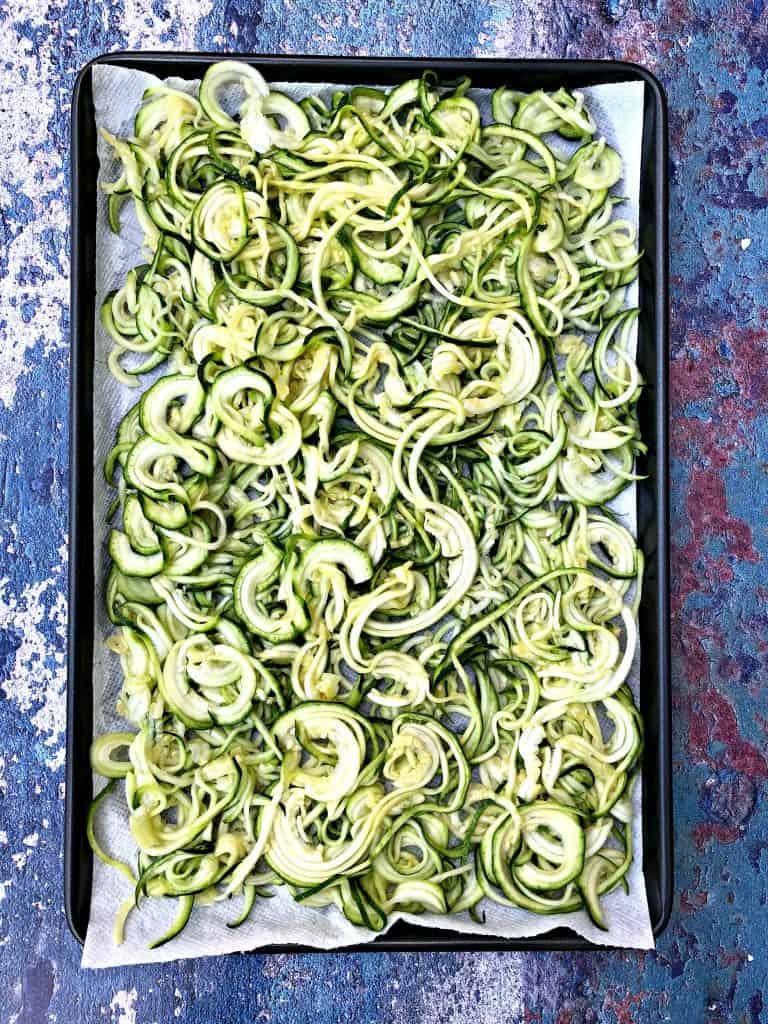 spiralized zucchini on a sheet pan
