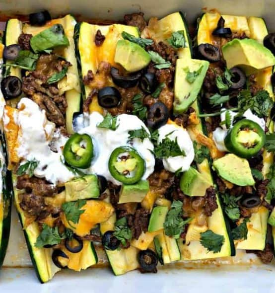 zucchini nachos with olives and sour cream