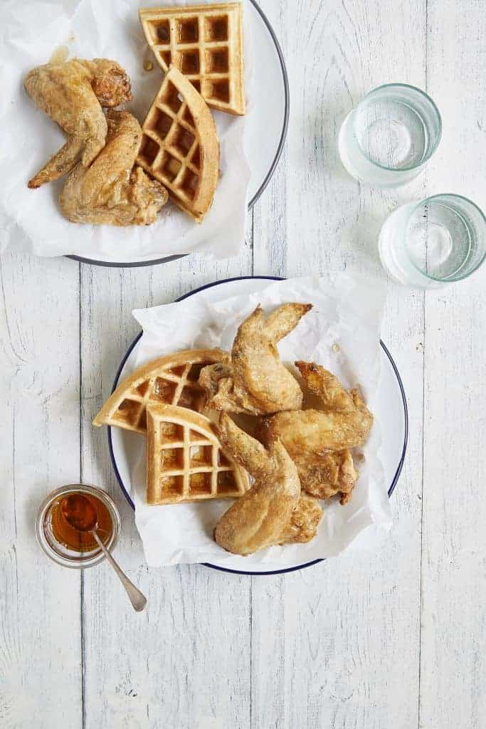 air fryer chicken and waffles on white place