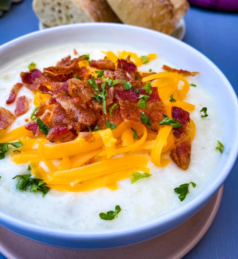 instant pot potato soup with bacon and cheese in 3 bowls