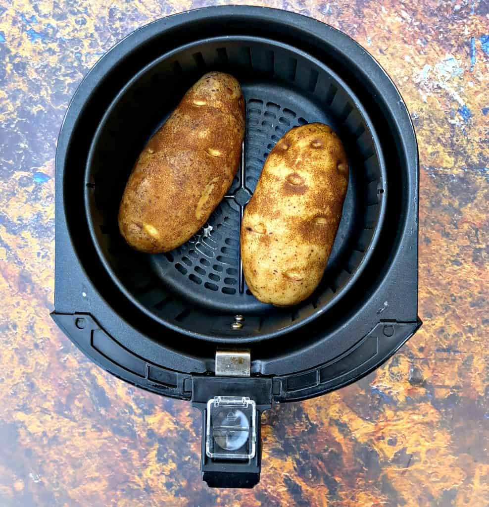 potatoes in an air fryer basket