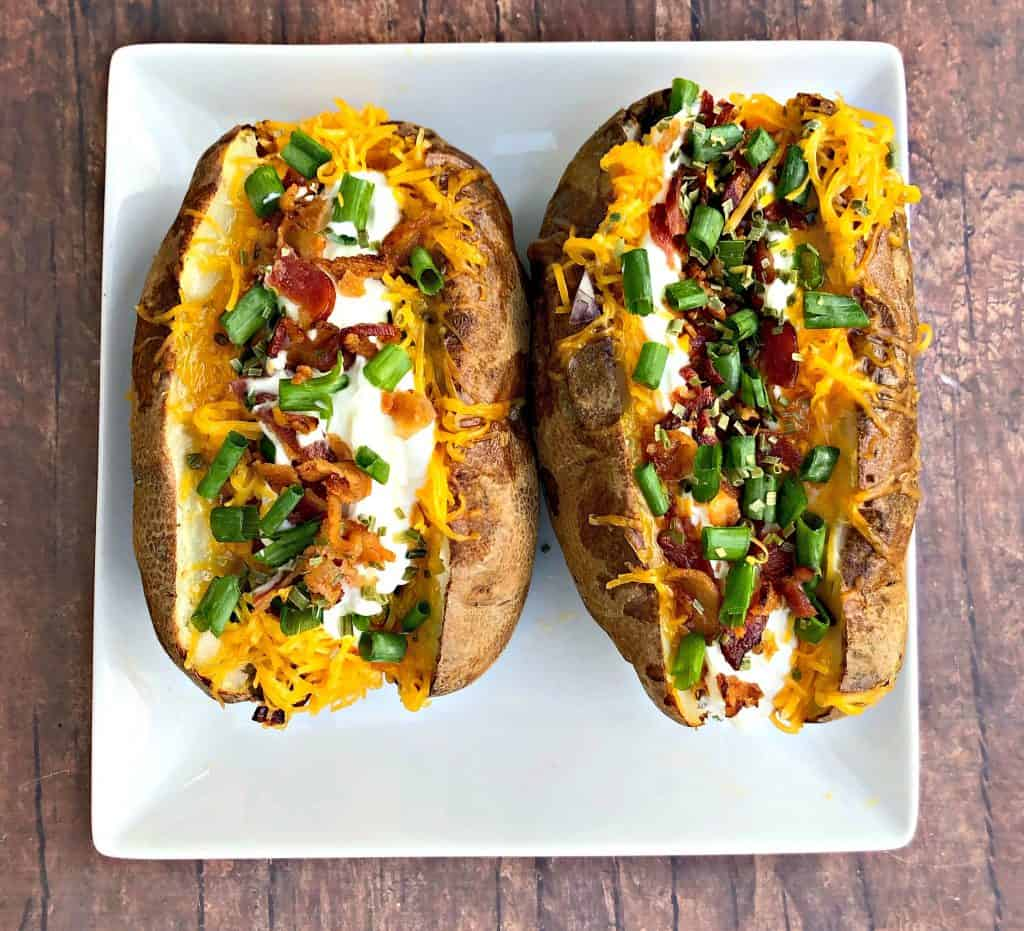air fryer loaded baked potato on a plate