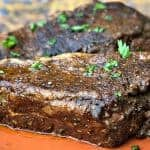 air fryer marinated steak on an orange plate