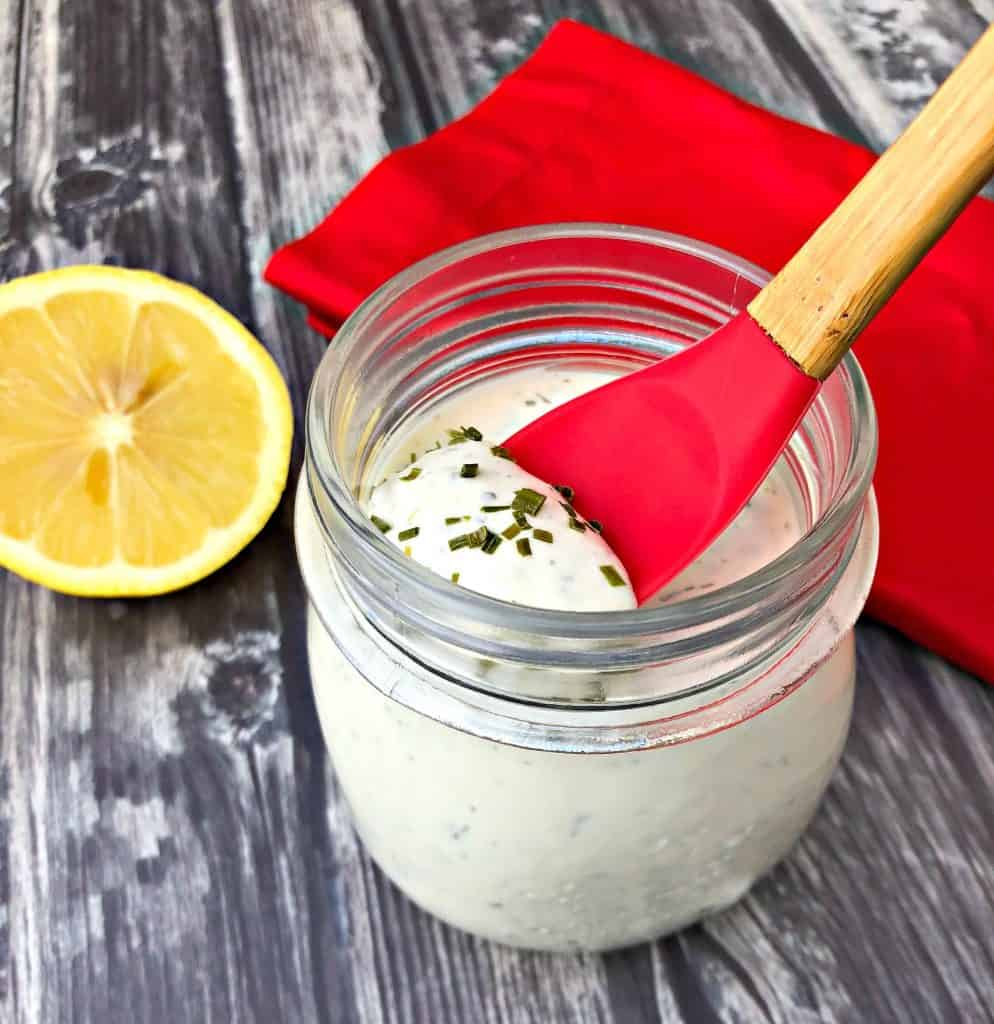 keto low carb ranch dressing with a spoon with lemon