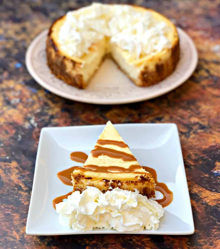 keto cheesecake low carb on a white plate with caramel and whipped cream