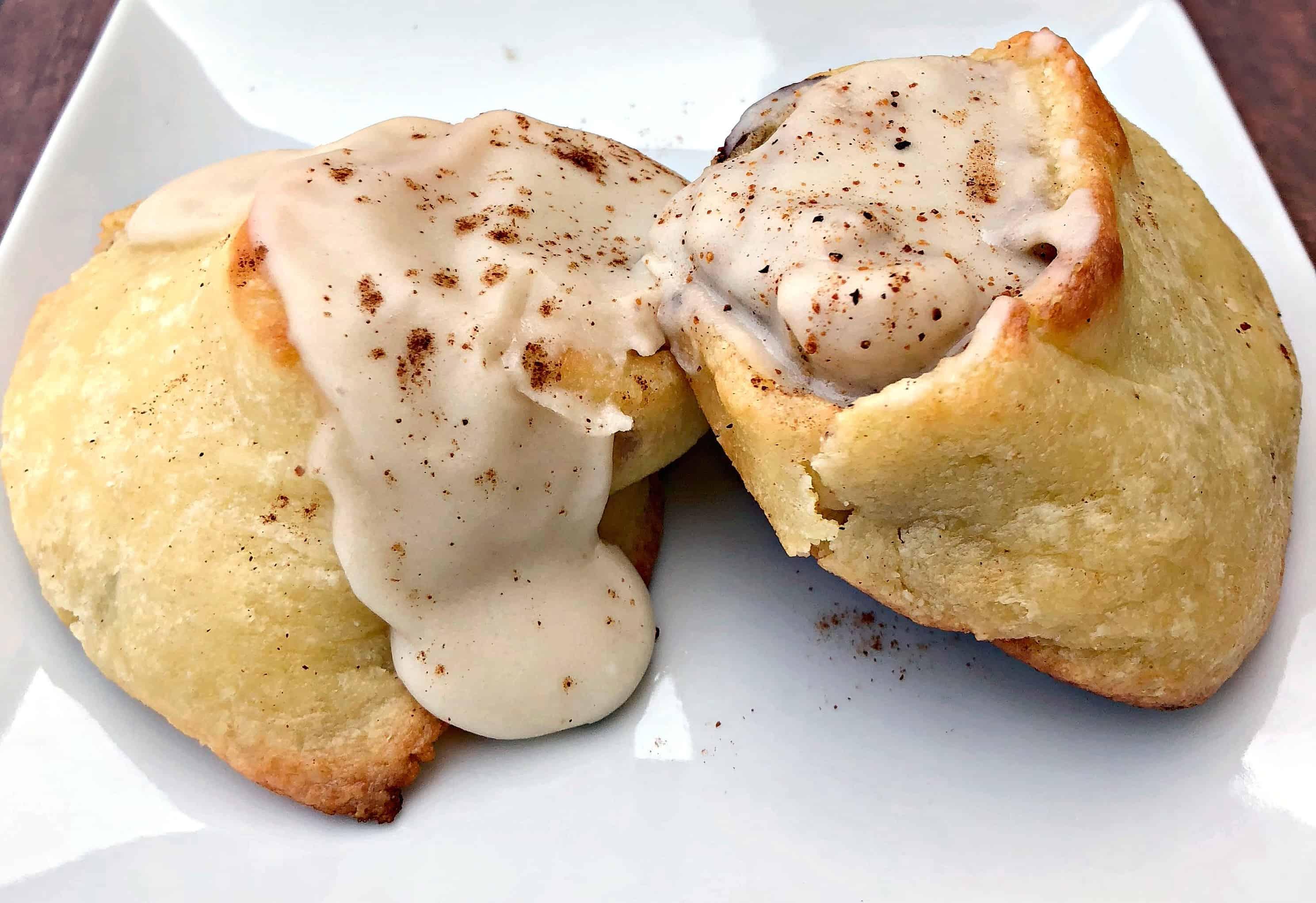 close up of keto fathead cinnamon rolls on a white plate