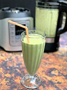 instant pot blender smoothie in a glass with a straw
