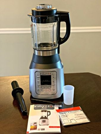 instant pot ace 60 cooking blender on a table with all boxed items