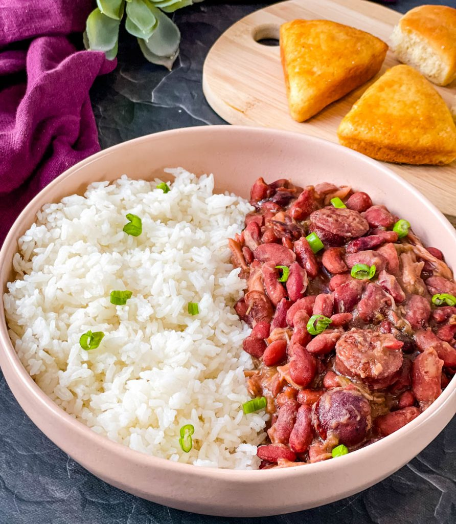 Instant Pot red beans and rice in a pink bowl