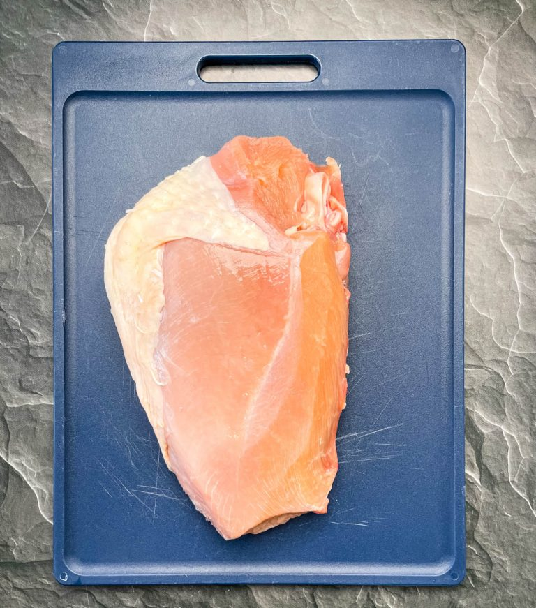 raw, seasoned turkey breast