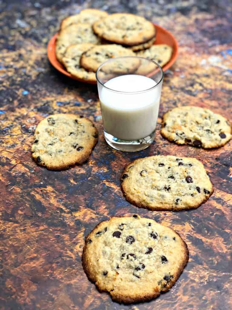 keto chocolate chip cookies on a plate with a glass of milk