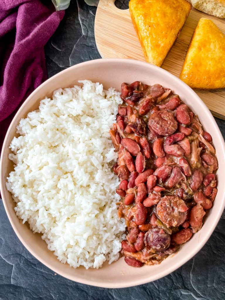 instant pot red beans and rice in a brown bowl with bread