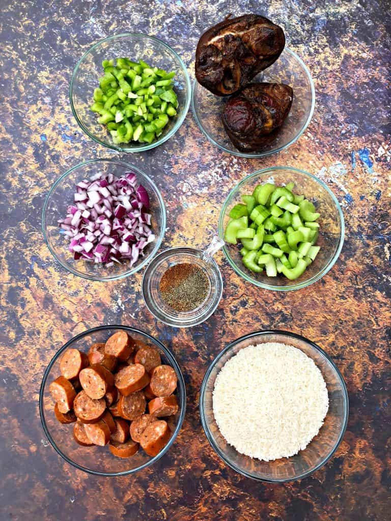 ingredients for red beans and rice in glass bowls