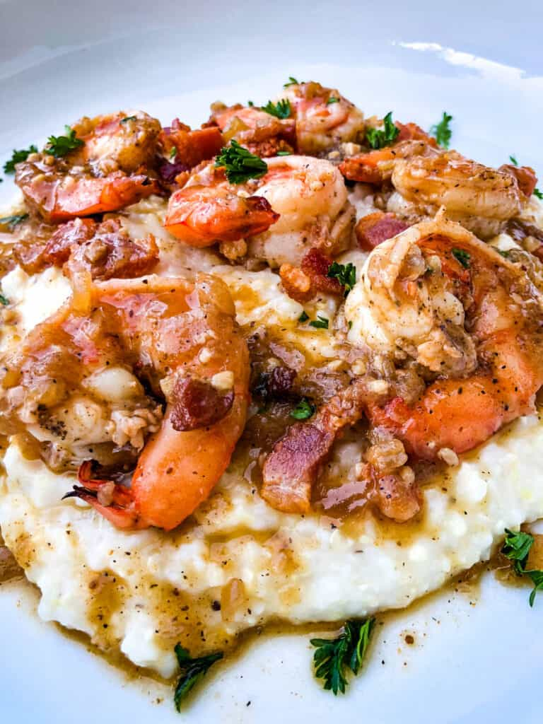 shrimp and grits on a white plate