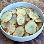 air fryer potato chips in a white bowl