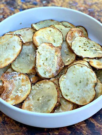 air fryer potato chips in a white bowl