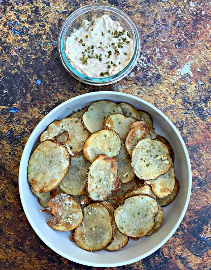 air fryer potato chips in a white bowl with dip