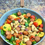 cajun chicken sausage and vegetables in a skillet