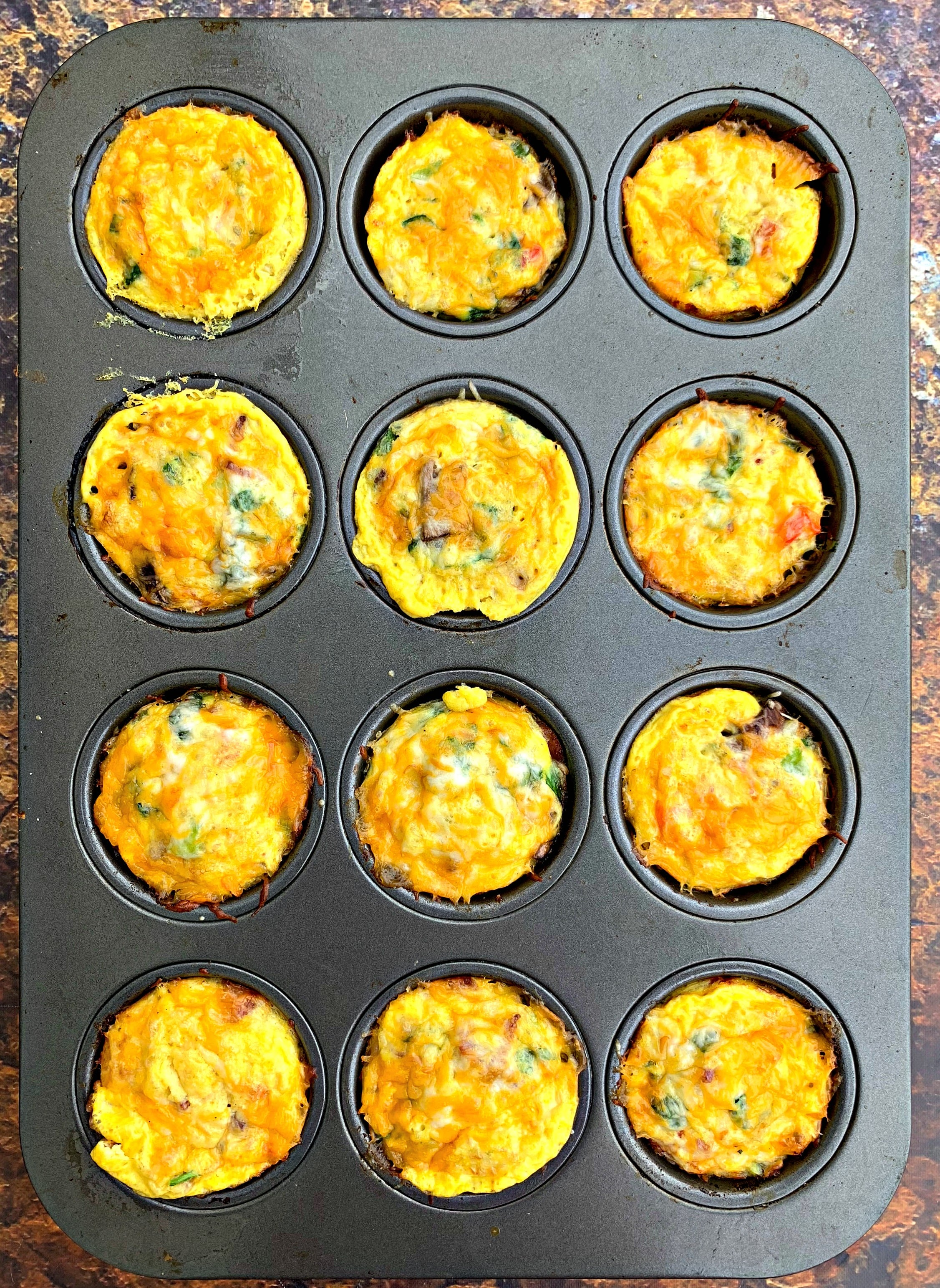 keto bacon egg bites in a muffin tin