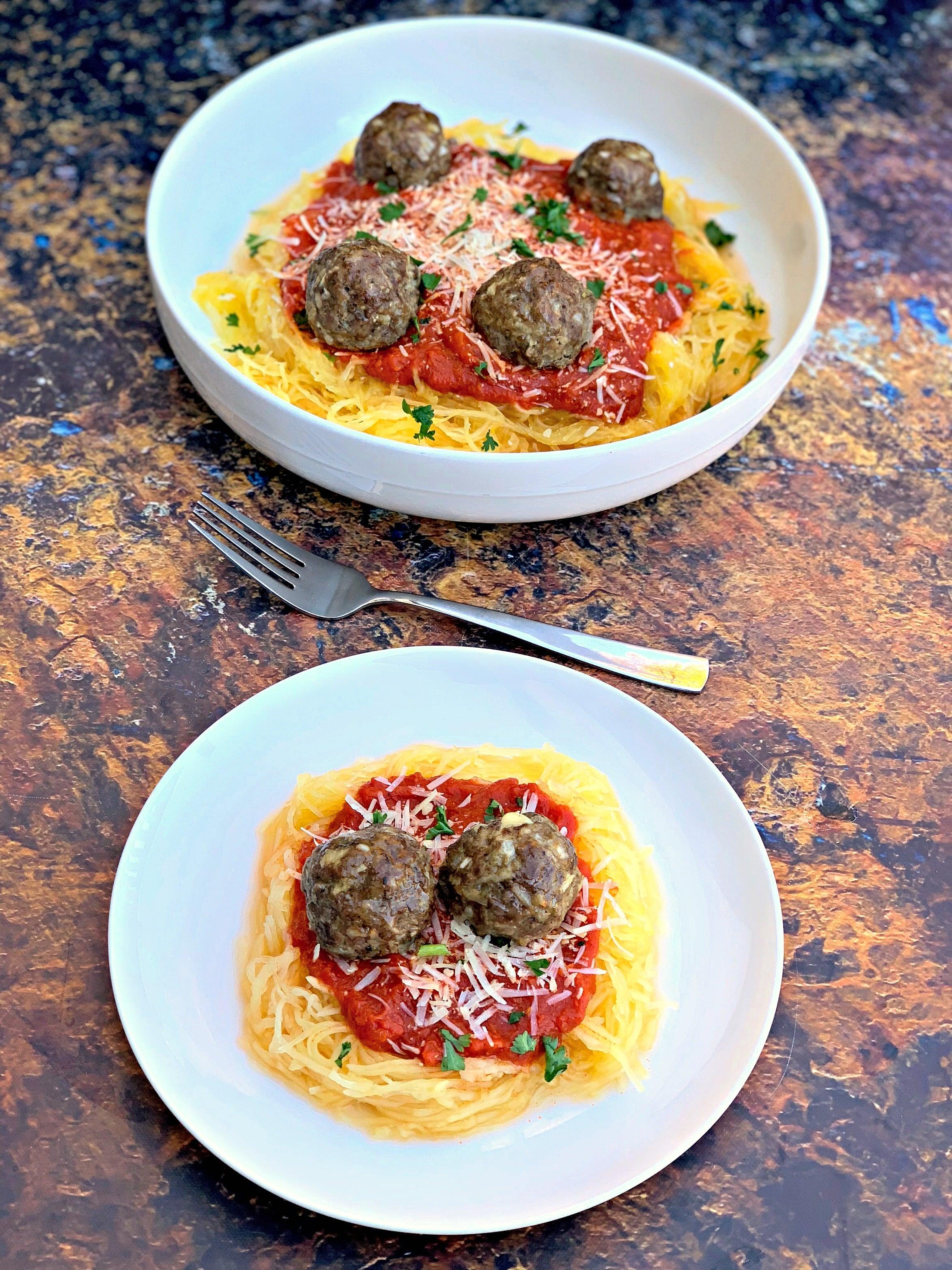 spaghetti squash marinara in a white bowl with a white plate