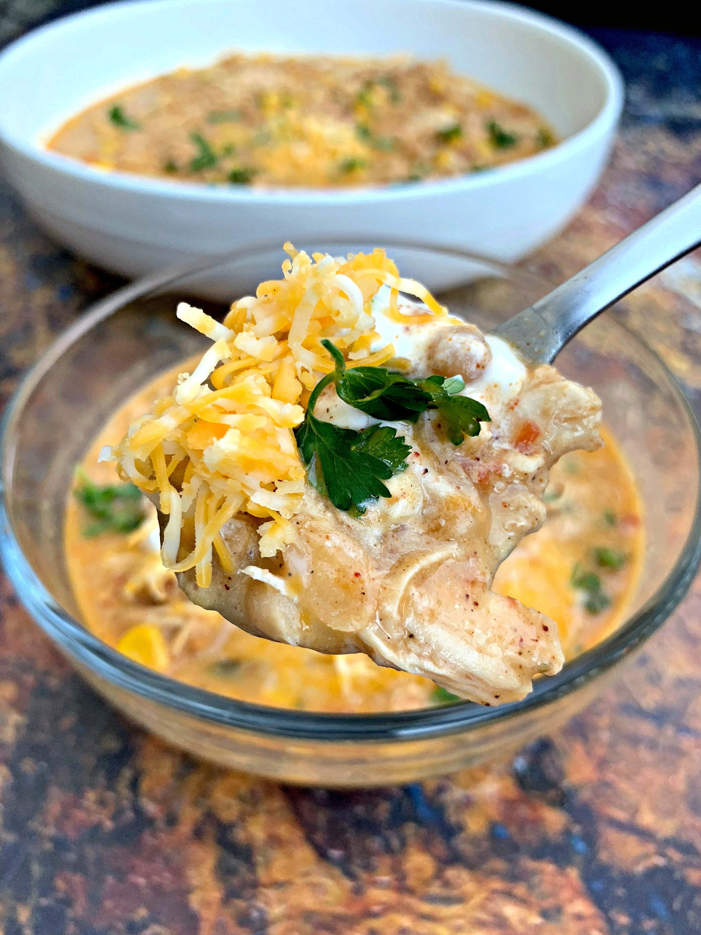 a close up of a spoon of instant pot white chicken chili