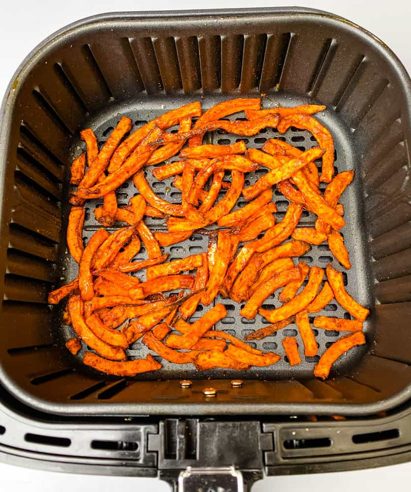 cooked sweet potato fries in an air fryer