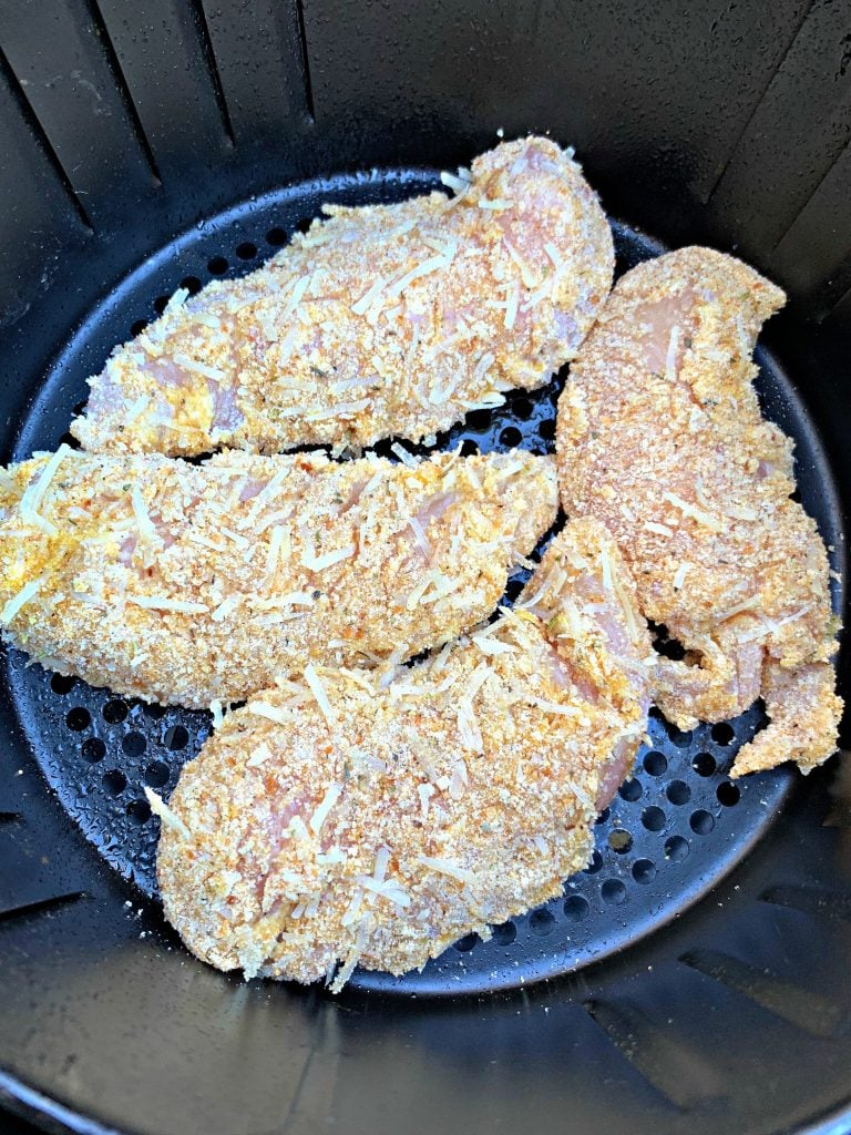 raw chicken tenders in an air fryer