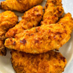 air fryer fried chicken tenders on a white plate with ranch