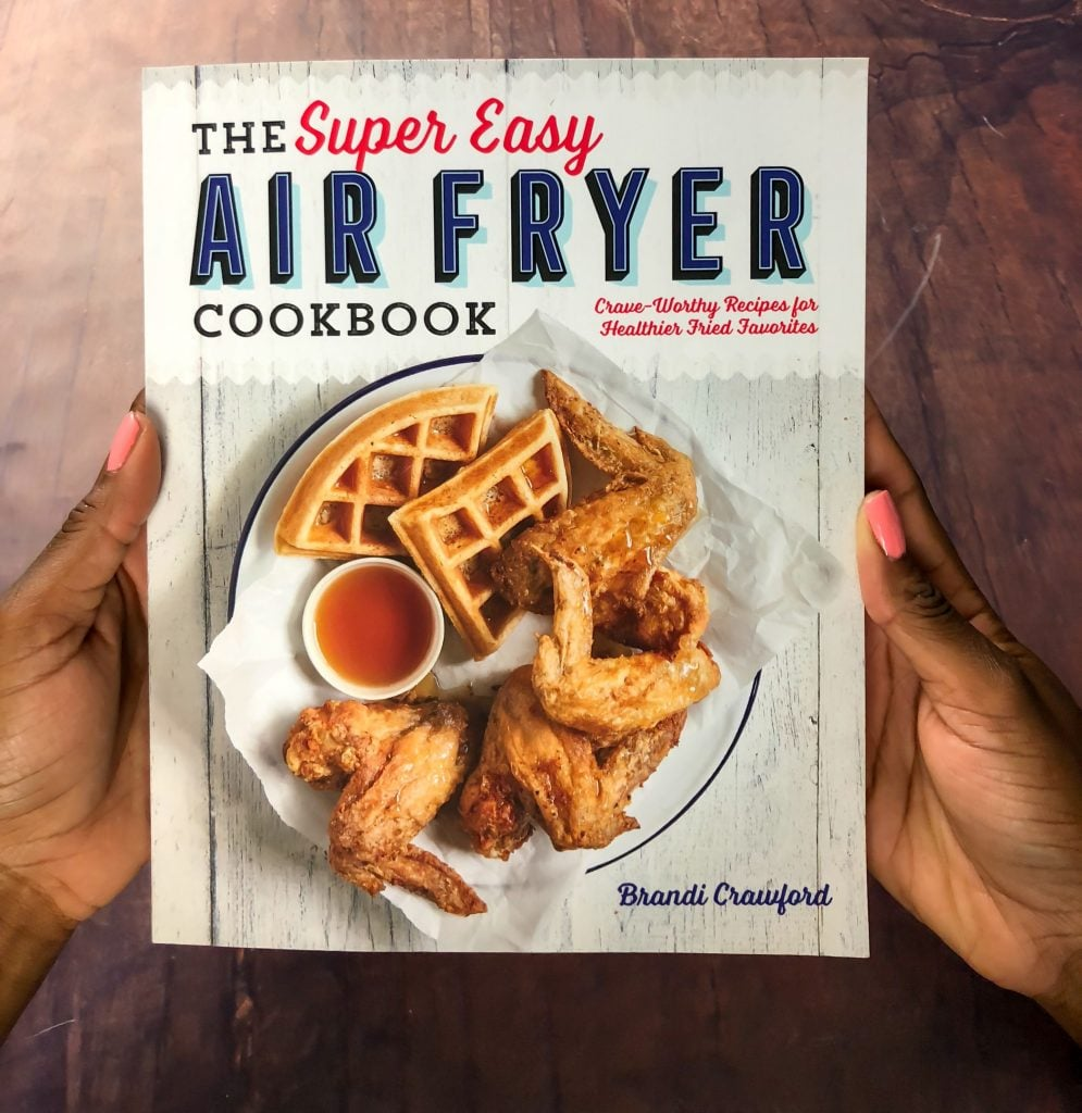 person holding air fryer cookbook
