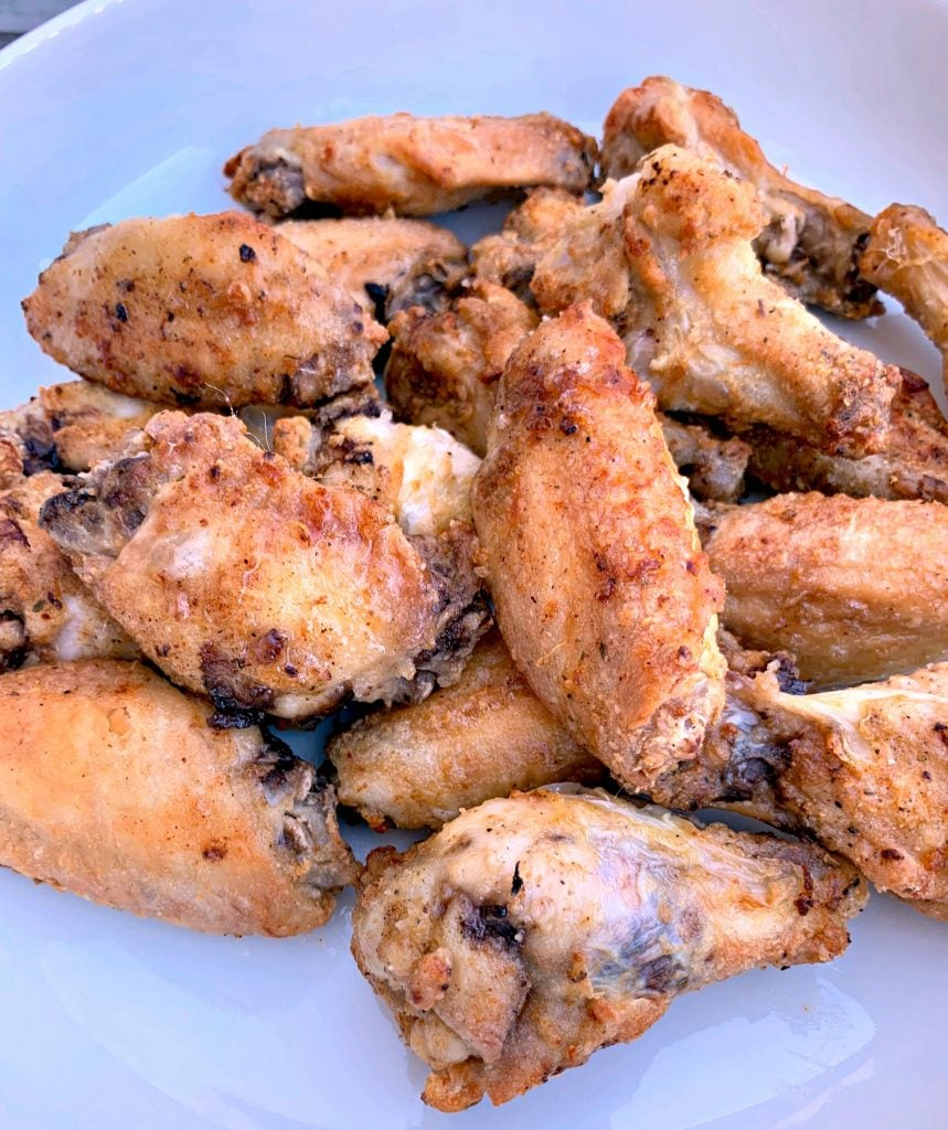 fried air fryer chicken wings in a white bowl