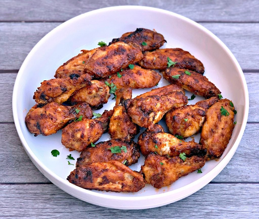 air fryer honey bbq chicken wings in a white bowl
