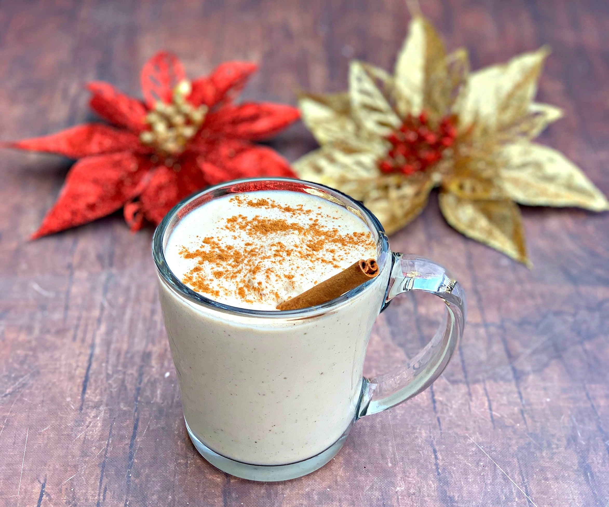 keto low carb egg nog in a mug with holiday decor in the background