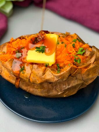 air fryer baked sweet potato with butter drizzled with honey