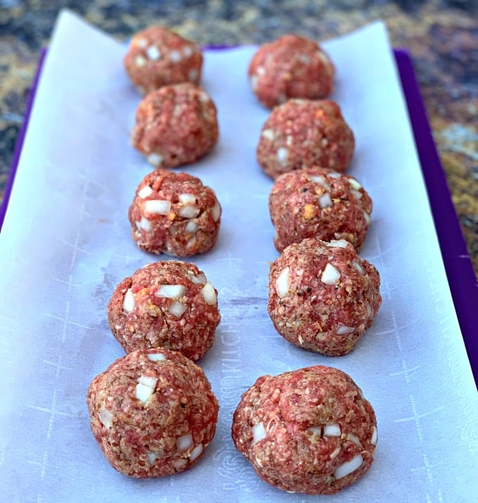 raw keto low carb meatballs on parchment paper