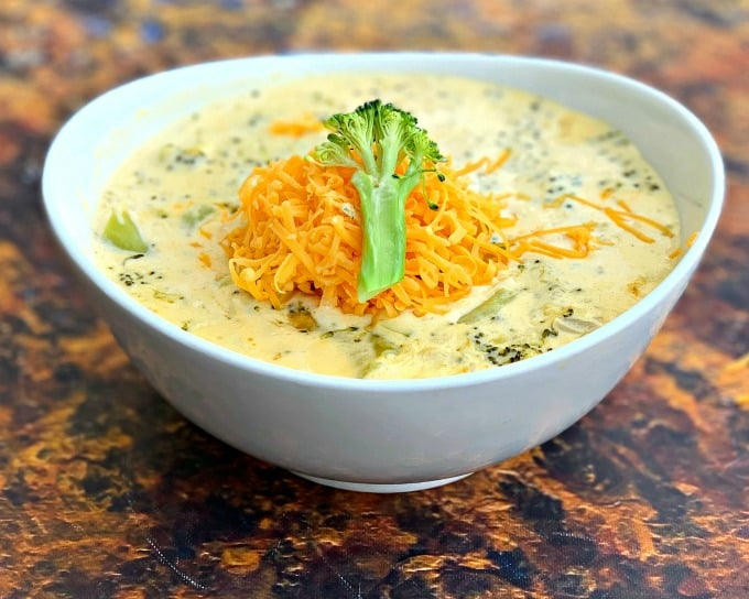 keto low carb instant pot broccoli cheddar soup in a white bowl