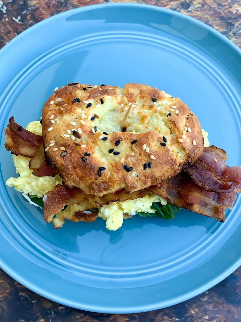 cooked keto fathead bagel sandwich with bacon and eggs