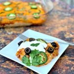 keto low carb enchilada casserole on a white plate and in a baking dish