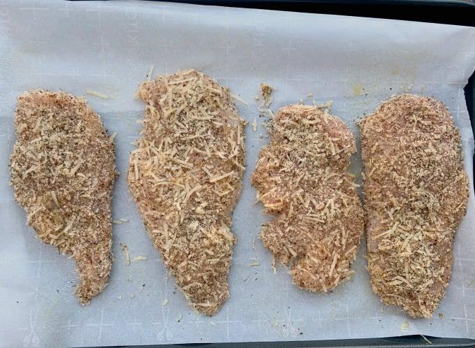 keto parmesan chicken on parchment paper