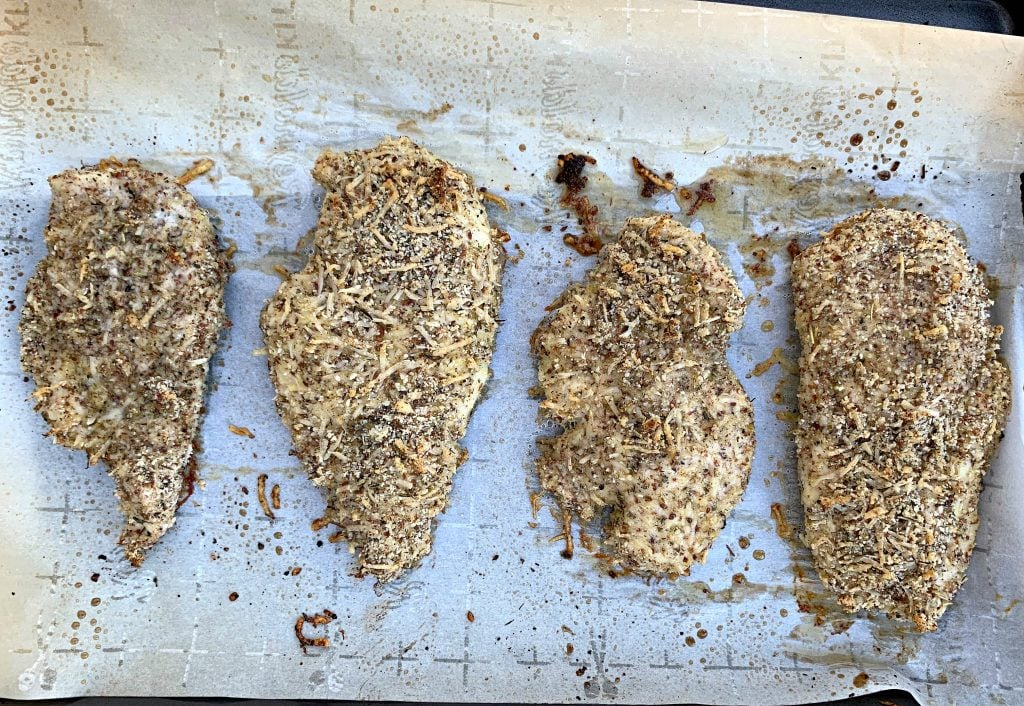 keto parmesan chicken on parchment paper