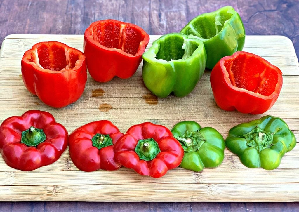 red and green fresh peppers on a cutting board