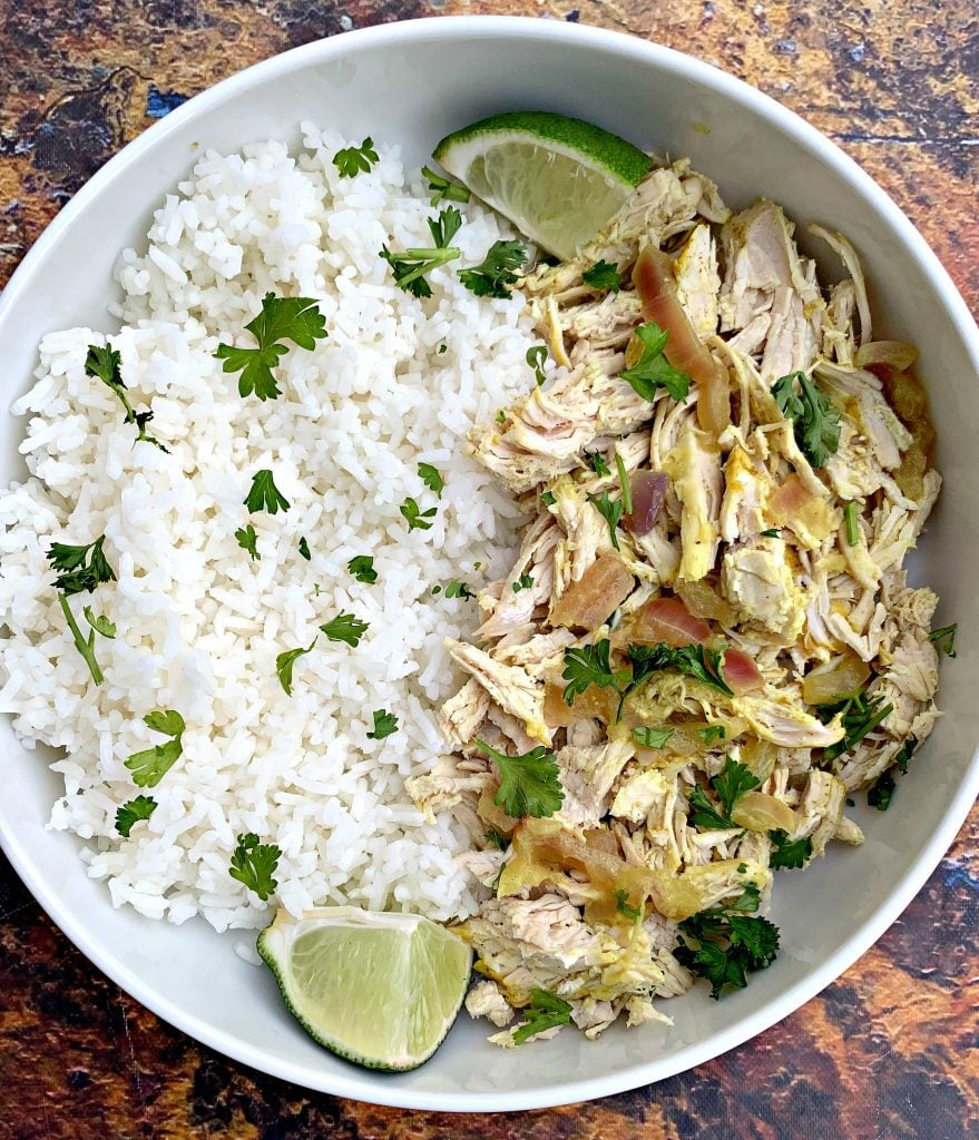 curry chicken and jasmine rice in a white bowl